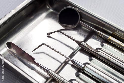 Poster de jardin Metal dental tools on white background top view. Stomatology