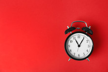 Alarm Clock On Color Background. Time Change Concept
