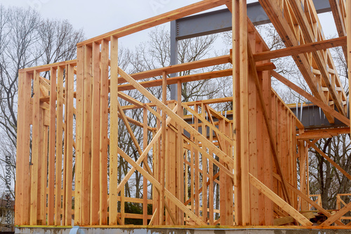 Poster Industrial geb. New home construction framing of a house on clear day