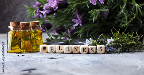 Recess Fitting Aromatische lavender oil in a glass bottle on a background of fresh flowers.