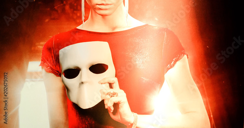 фотография  young woman holding mask