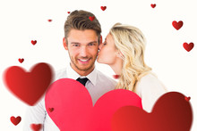 Attractive Young Couple Holding Red Heart Against Hearts