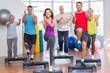 Leinwanddruck Bild - People performing step aerobics exercise in gym