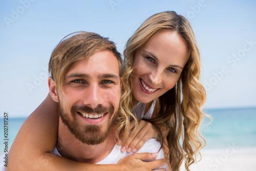 Close up portrait of boyfriend piggybacking girlfriend Poster