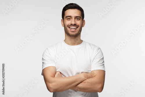 Half-length indoor portrait of young European Caucasian man isolated on gray bac Canvas Print
