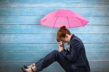 Businesswoman With Umbrella Ag...