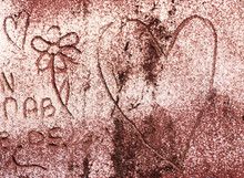 Abstract Symbol Of Heart And Flower Scrawled On The Brick Wall.