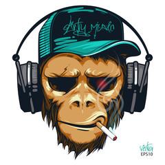 Fototapeta Music fan hipster monkey in headphone. DJ chimpanzee
