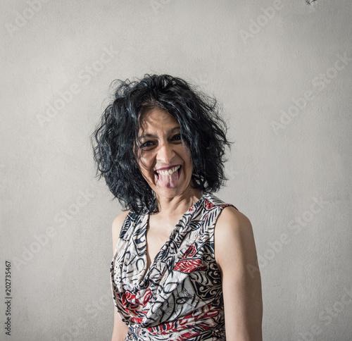Vászonkép donna irriverente che fa la linguaccia