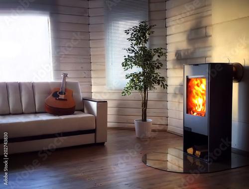 Wood burning stove in cozy living room Fototapeta