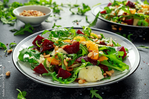 Fresh Beet, Orange salad with wild rocket, cheese and Pine nuts. healthy summer food