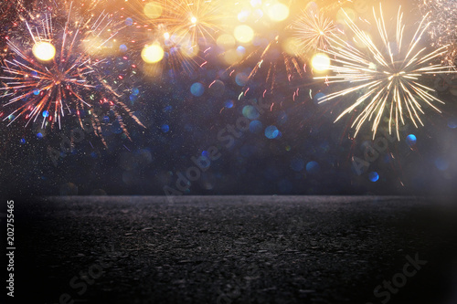 Obraz abstract black and gold glitter background with fireworks and asphalt floor or stage. christmas eve, 4th of july holiday concept. - fototapety do salonu