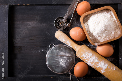 Photo sur Toile Cuisine ingredients for baking : flour, eggs and kitchen utensils for cooking