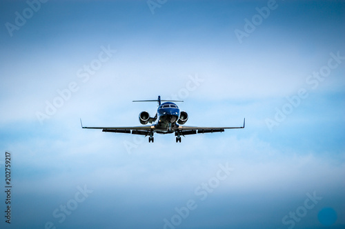 Tuinposter Helicopter Luxurious black jet coming in for landing.