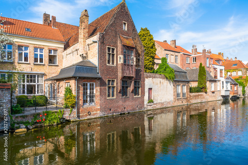 Wall Murals Bridges View of a canal and old historical buildings in Bruges, Belgium