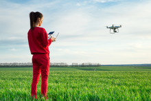 Female Flying A Drone At The Field