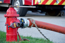 Fire Hydrant In Use During A Structure Fire
