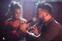 Male Singer Performing On Stage At Nightclub