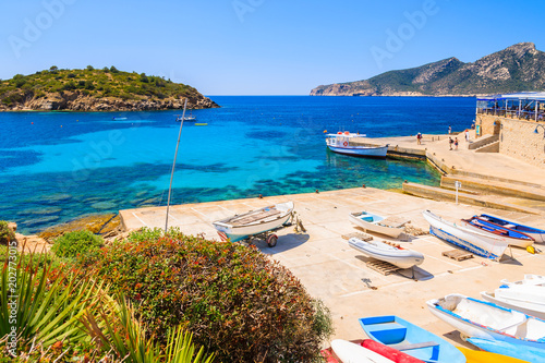 Foto auf Leinwand Orange Fishing boats on shore in Sant Elm village, Majorca island, Spain