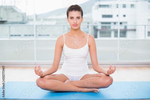 Fotobehang School de yoga Calm natural brown haired woman in white sportswear practicing yoga