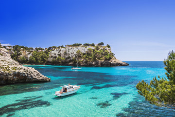 Beautiful bay with sailing boats and yachts, Cala Galdana, Menorca island, Spain. Yachting, travel and active lifestyle concept
