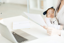 Cute Sleeping Baby Girl With Teddybear On Her Business Mother Hands Spending Day In Office