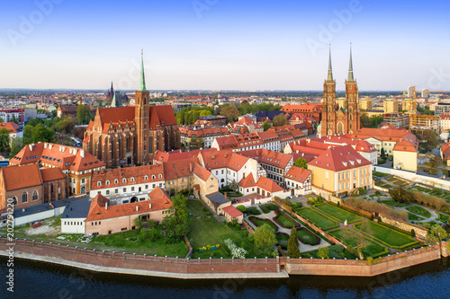 Poland. Wroclaw. Ostrow Tumski district with Gothic cathedral of St. John the Baptist,  Collegiate Church of the Holy Cross and St. Bartholomew and Odra (Oder) River. Aerial view in sunset light