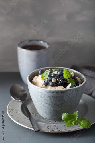 Foto op Plexiglas Chocolade healthy breakfast steel cut oatmeal porridge with blueberry blackberry