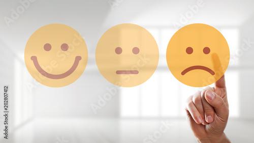 Fotografie, Obraz  Finger wählt traurigen Smiley aus