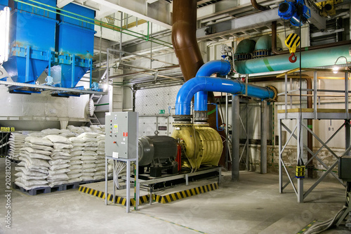 Staande foto Industrial geb. Pumps of air pumping station of wastewater treatment plant and bags with disinfectant