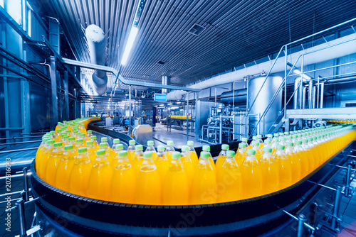 Beverage factory interior. Conveyor with bottles for juice or water. Equipments