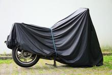 Motorcycle, Motorbike Under The Tarpaulin. Parking For Motorcycles. Moto Camping