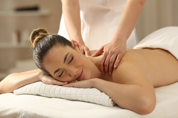 Relaxed lady receiving a massage in a spa