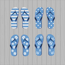 Four Pair Of Different Flip Flops - Blue White Colors On Grey Wooden Background