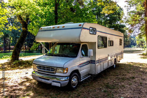Fotografering Family trip in motorhome in forest or park in South Chile