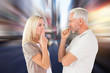 Couple staying silent with fingers on lips against blurry new york street
