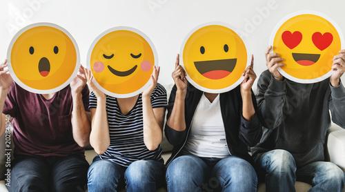 Obraz Diverse people holding emoticon - fototapety do salonu