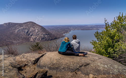 Canvas Print Young couple overlooking Hudson River at Bull Hill near Cold Spring, NY