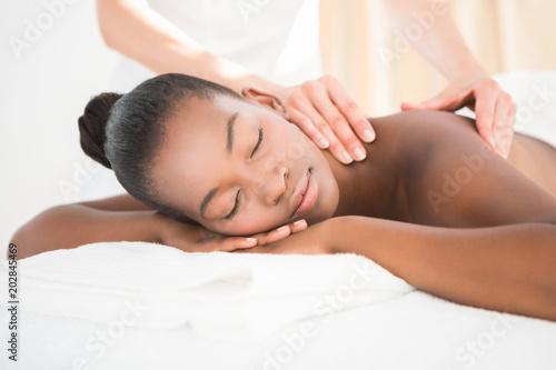 Fotografie, Obraz  Pretty woman enjoying a massage