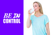 Leinwandbild Motiv Pretty blonde drinking glass of water against purple vignette