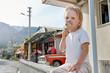 Cute blonde boy eating ice-cream in tropical resort