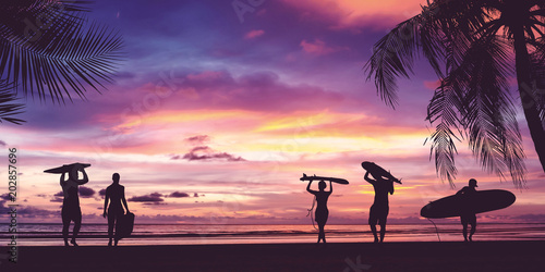 Fototapeta Silhouette of surfer people carrying surfboard