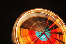 Motion Blurred Ferris Wheel At...