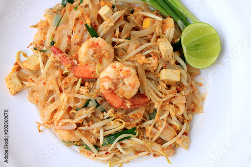 Tuinposter Klaar gerecht Thai style noodles, Pad Thai, stir-fried rice noodles with shrimp serve with vegetable in white plate on white background. The one of Thailand's national main dish. the popular food in Thailand.