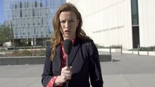 MS Smartly Dressed Female TV Reporter Talks With Microphone In Front Of Los Angeles Police Department Headquarters In Downtown Los Angeles. Hand-held, Stabilized, Real Time 4K UHD. Mute