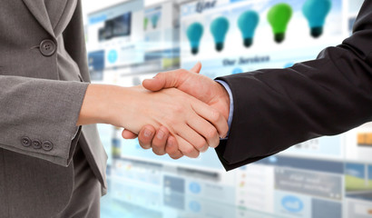 Close up of two businesspeople shaking their hands against screen collage showing business advertisement