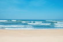 Sandy Beach And Choppy Waves. White Sand, Blue Sky And Crystal Sea Of Tropical Beach
