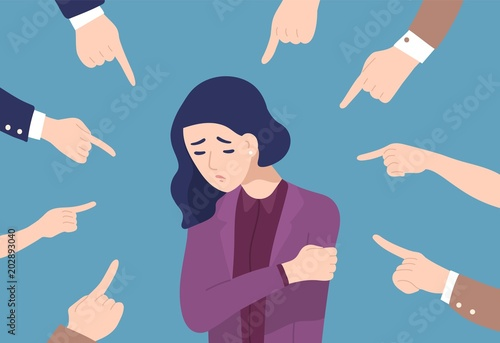 Fotografía Sad or depressed young woman surrounded by hands with index fingers pointing at her