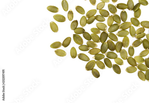 Fotografie, Obraz  Pumpkin seeds isolated on white background, top view
