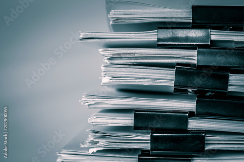 Fotografie, Obraz  extreamely close up a  report paper stacking of office working document , retro